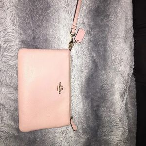 Rose colored Coach wristlet